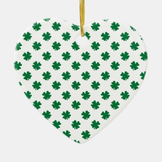 Four leaf clovers in green christmas ornament