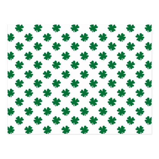 Four leaf clovers in green post card