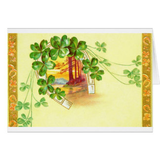 Four leaved clover and horseshoe greeting card