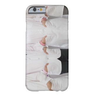 Four pharmacists with their hands in their barely there iPhone 6 case