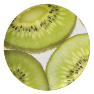 Four pieces of sliced kiwi plate