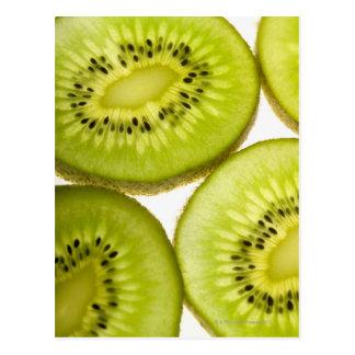 Four pieces of sliced kiwi postcard