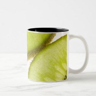 Four pieces of sliced kiwi Two-Tone coffee mug