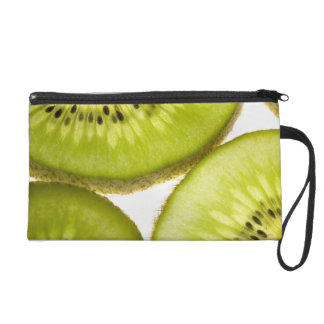 Four pieces of sliced kiwi wristlet purse