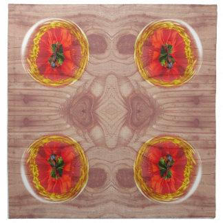 Four poppy globes on wood napkin