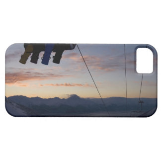 Four snowboarders are silhouetted on a ski lift iPhone 5 covers