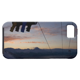 Four snowboarders are silhouetted on a ski lift tough iPhone 5 case