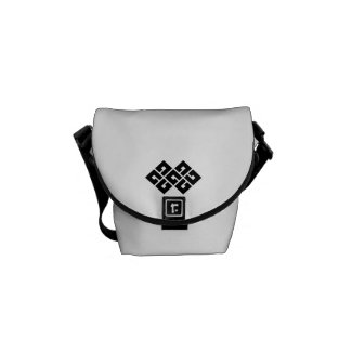 Four squares joining two commuter bags