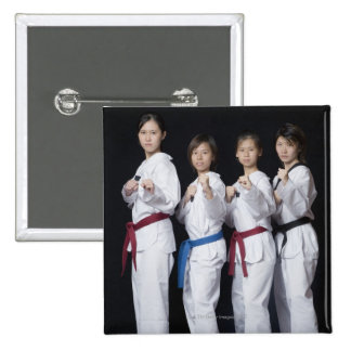 Four young women standing in punching position 15 cm square badge