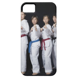 Four young women standing in punching position iPhone 5 case