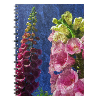Foxglove flowers on texture with frame notebook