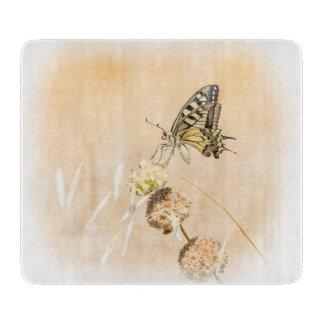 Fragile beauty of swallowtail butterfly cutting board