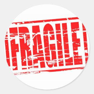 Fragile red rubber stamp effect round sticker