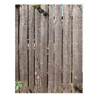 Fragment of a fence from wooden planks postcard