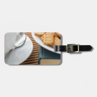 Fragment of a saucer with a cup of tea luggage tag