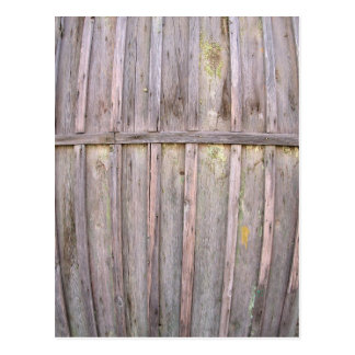 Fragment of an old wooden fence from boards postcard