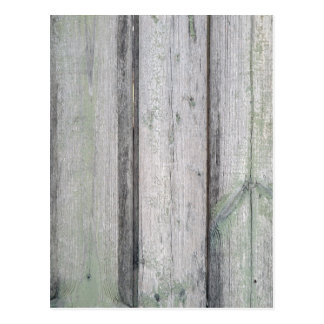 Fragment of an old wooden fence postcard