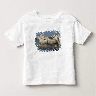 France, Camargue. Horses run through the estuary Toddler T-Shirt