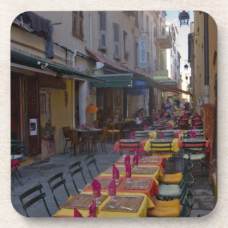 France, Corsica. Tables of cafe set up in narrow Coaster