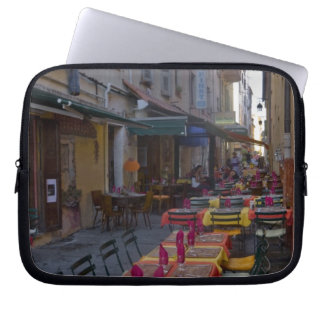 France, Corsica. Tables of cafe set up in narrow Laptop Sleeve