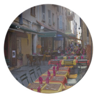 France, Corsica. Tables of cafe set up in narrow Plate
