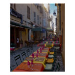France, Corsica. Tables of cafe set up in narrow Poster