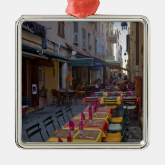France, Corsica. Tables of cafe set up in narrow Silver-Colored Square Decoration