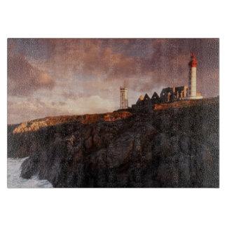 France, lighthouse at dawn cutting board