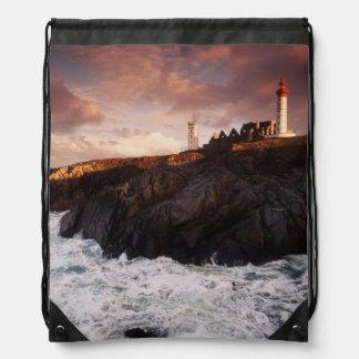 France, lighthouse at dawn drawstring bag