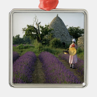 France, PACA, Vaucluse, Woman in a lavender Christmas Ornament