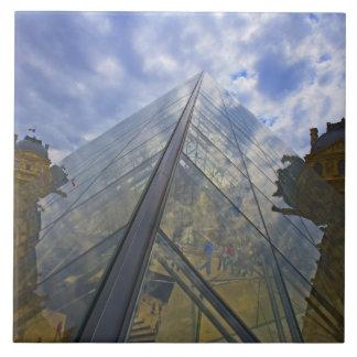 France, Paris. Clouds reflect off the Louvre Tile