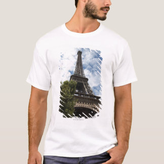 France, Paris, Eiffel Tower and tree, low angle T-Shirt