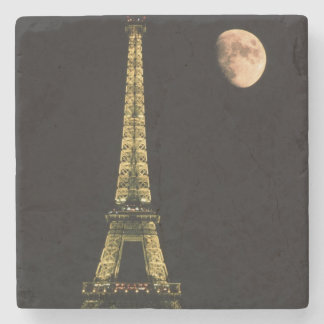 France, Paris. Eiffel Tower at night with Stone Coaster