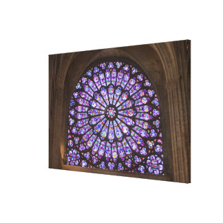 France, Paris. Interior detail of stained glass Canvas Print
