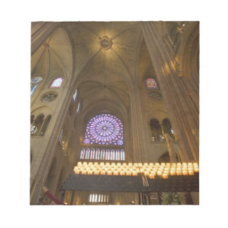 France, Paris. Interior of Notre Dame Cathedral. Notepad