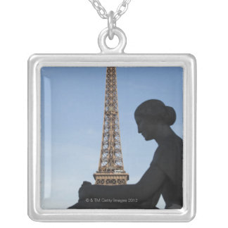 France, Paris, Statue of woman in front of Silver Plated Necklace