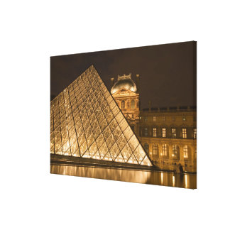 France, Paris. The Louvre at twilight. Credit Canvas Print