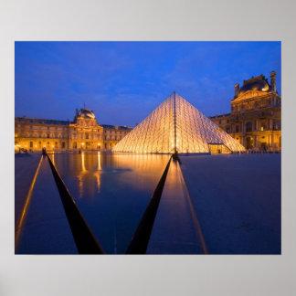 France, Paris. The Louvre museum at twilight. Poster