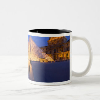 France, Paris. The Louvre museum at twilight. Two-Tone Coffee Mug