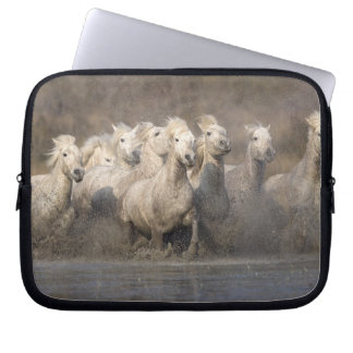 France, Provence. White Camargue horses running Laptop Sleeve