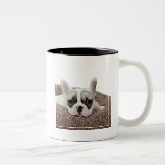 French Bulldog Puppy Lying In A Dog Bed Two-Tone Coffee Mug