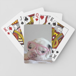 French bulldog white cub Glasses, lying on white Playing Cards