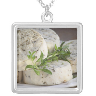 French goat cheese - chevre - with herbs on a silver plated necklace
