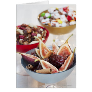 Fresh and dried fruits in bowls card