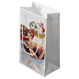 Fresh and dried fruits in bowls small gift bag