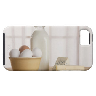 Fresh eggs cheese and milk on counter case for the iPhone 5