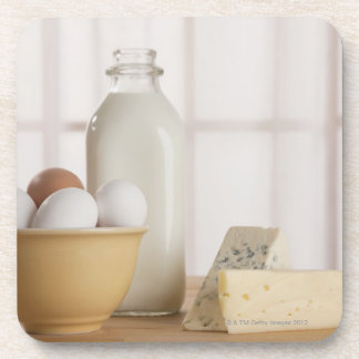 Fresh eggs cheese and milk on counter coaster