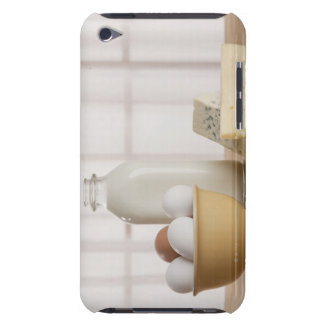 Fresh eggs cheese and milk on counter iPod touch cases