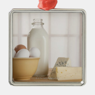 Fresh eggs cheese and milk on counter Silver-Colored square decoration
