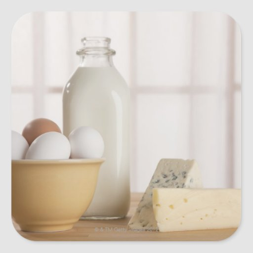 Fresh eggs cheese and milk on counter square stickers